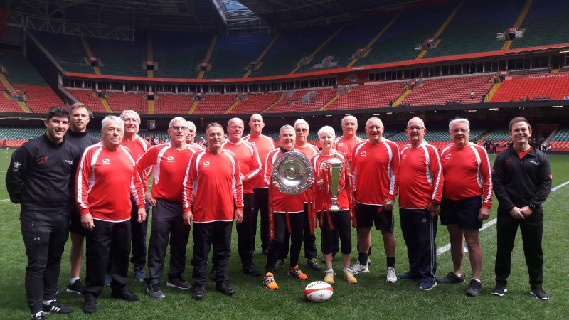 Pontyclun Walking Rugby team at the Principality stadium with the 6 nations and triple crown trophies